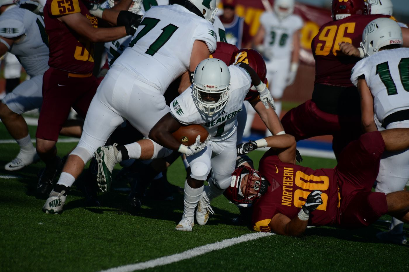 Alt throws four touchdowns, defense forces four turnovers in 33-7 win