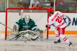 WHockey vs. Wisconsin Final Faceoff by Jim Rosvold
