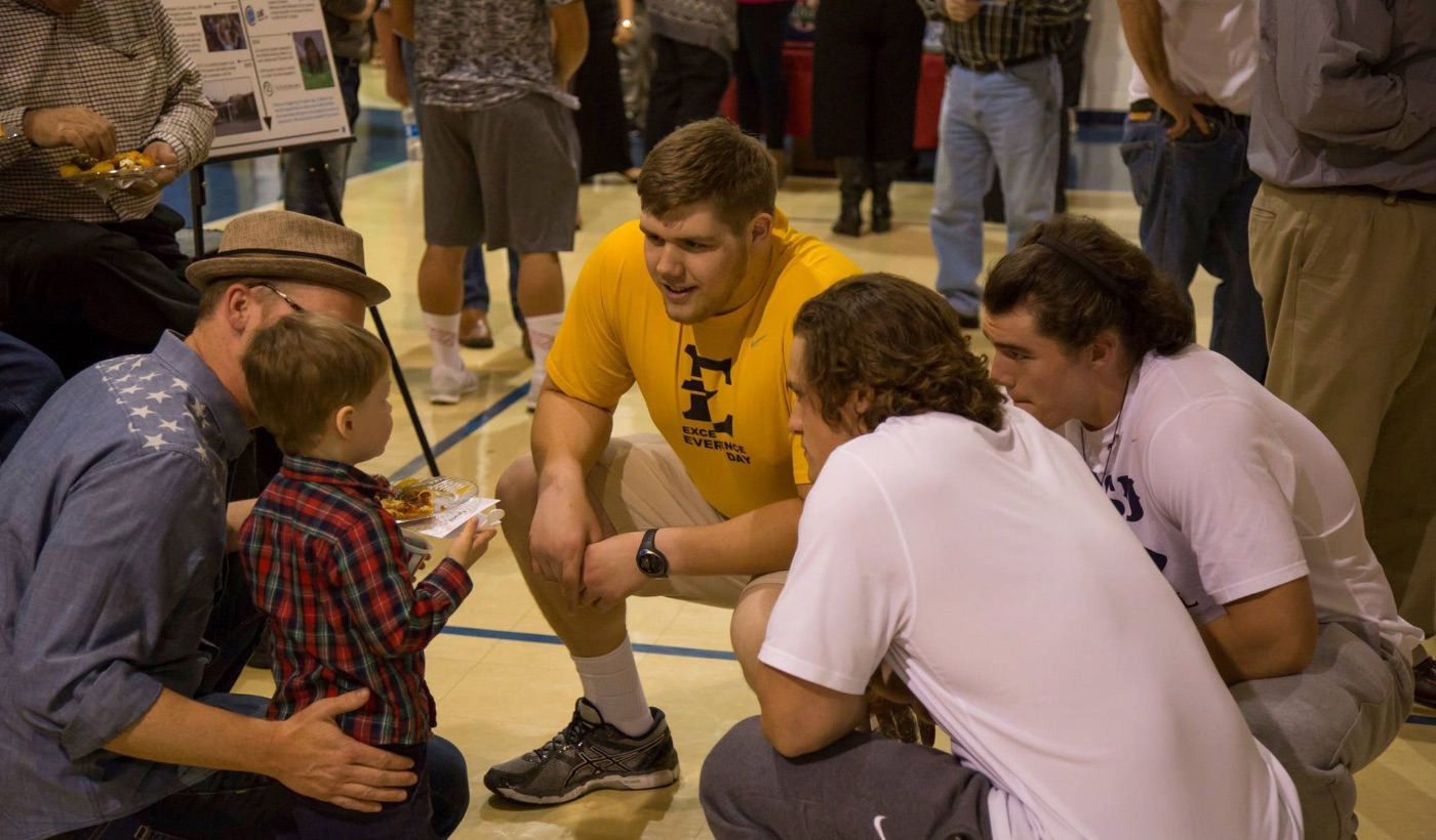 ETSU Football Attends Grand Opening for new Coalition for Kids facility