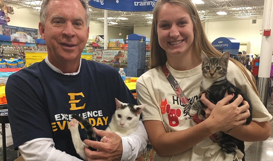 Bucs volunteer with Humane Society of Washington County Pet Adoption event