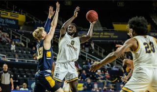 Bucs outdone by UNCG in overtime, 85-74