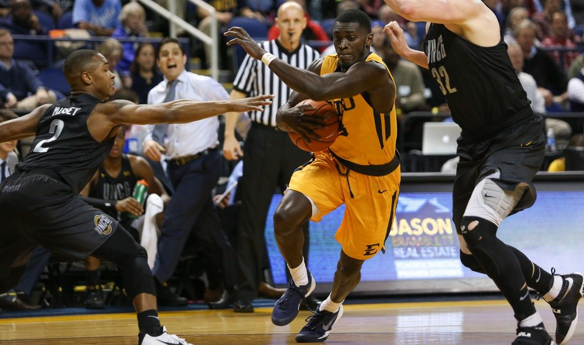Bucs share title as rally falls short at UNCG, 72-66