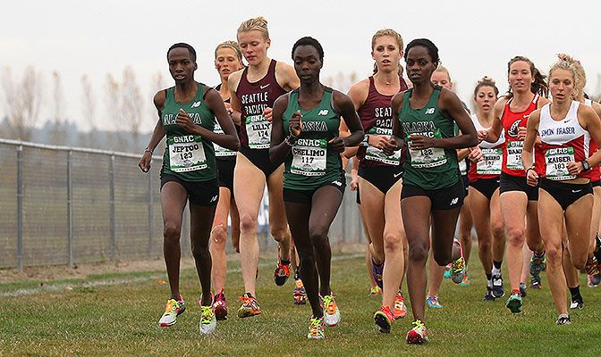 Flanked by teammates Nancy Jeptoo (left) and Zennah Jepchumba, Emmah Chelimo ran to her first GNAC championship. Photo by Jaime Valdez.