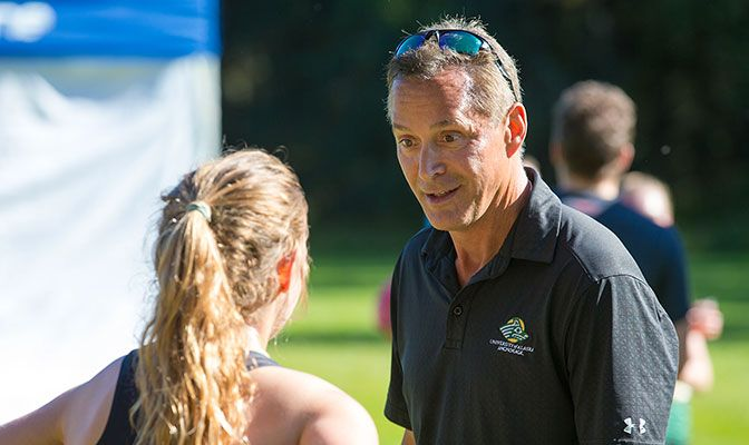 Michael Friess earned his 11th GNAC Men's Cross Country Coach of the Year and his eighth women's award.