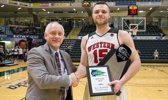 Vince Boumann, pictured with GNAC commissioner Dave Haglund, was named MVP after scoring 33 points in the championships. Photo by Skip Hickey.