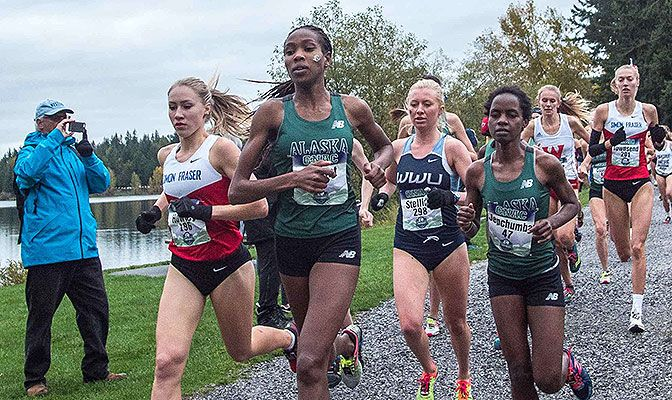 Caroline Kurgat (in green), ran away with the West Region title with a time of 20:26.1. Simon Fraser's Julia Howley (left) will join Kurgat at nationals. Photo by Nick Danielson.