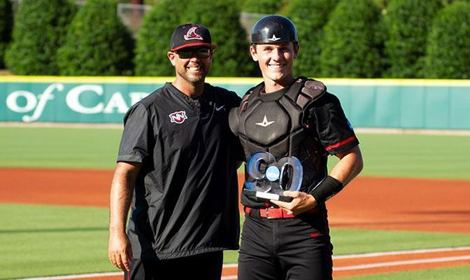 Ben Johnson, pictured with NNU head coach Joe Schaefer, has a 3.98 GPA as a double major in biology and biochemistry.