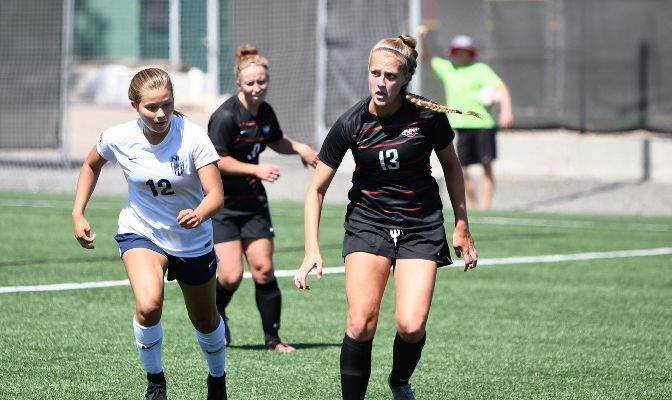 Northwest Nazarene's McKenzie Buell (right) has tallied two goals, seven assists and 11 points in six games this spring.
