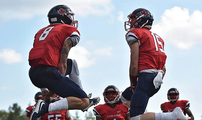 Miles Richardson (left), shown celebrating with Robert Meadors, threw for 180 yards and three touchdowns in the Clan's first win since 2014.