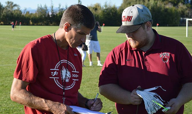 Kevin Adkisson, shown here with CWU assistant SID Caleb Dunlop, became the Wildcats' head coach after volunteering as a coach while a graduate student.