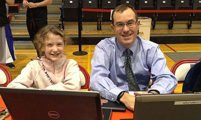 Blake Timm, shown here with his oldest daughter, Sydney, is in his third year directing communications efforts for the GNAC.