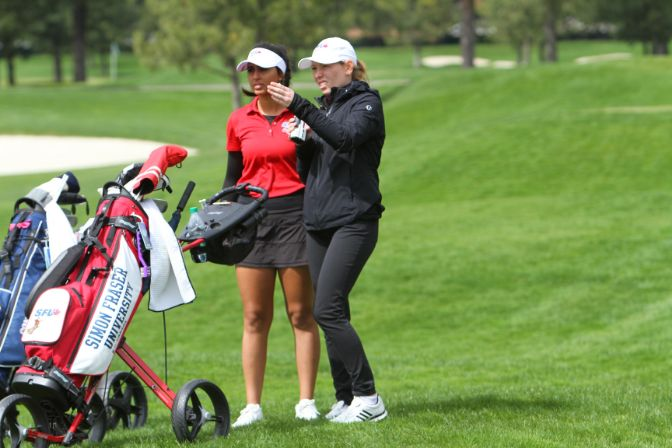 Junior Jaya Rampuri (left), shown here with assistant coach Nicole Jordan, finished in third place at the GNAC Championships to help lead her team to victory. Photo by Shawn Toner.