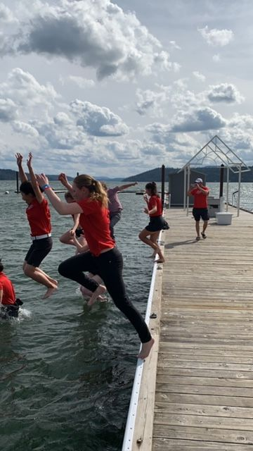 Simon Fraser took a celebratory leap into Lake Coeur d'Alene after Tuesday's title. Photo by Nick Schmidt.