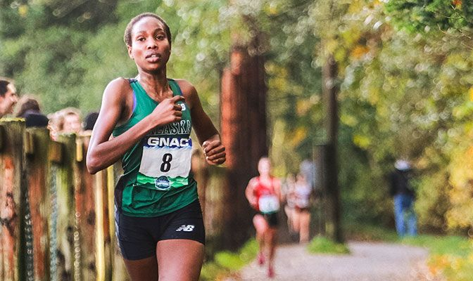 Caroline Kurgat won an exciting competition between the GNAC's top women's runners, finishing in 21:17.10 to beat Saint Martin's Shannon Porter by six seconds. Photo by Nick Danielson.