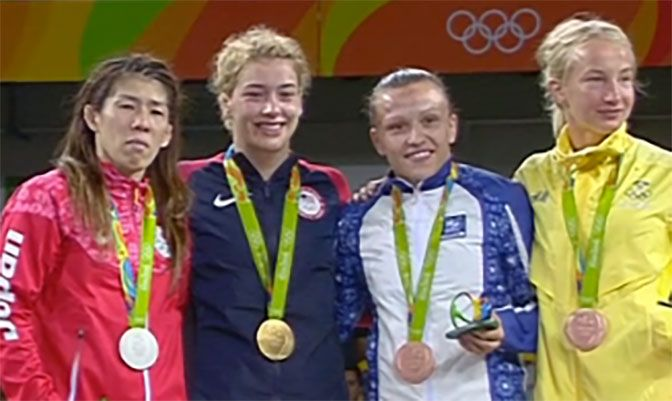 To earn her gold medal, Helen Margolis (second from left) beat 16-time world champion and three-time Olympic champ Saori Yoshida of Japan (left). Courtesy of IOC.