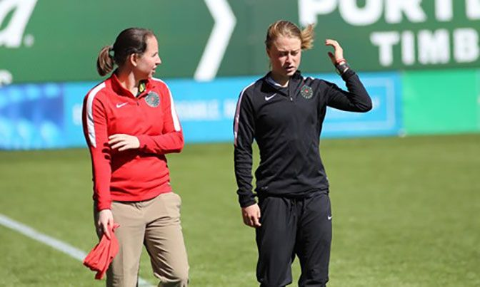Prior to her work with the Portland Thorns, Simons (left) spent two years as the sports information director at Saint Martin's.