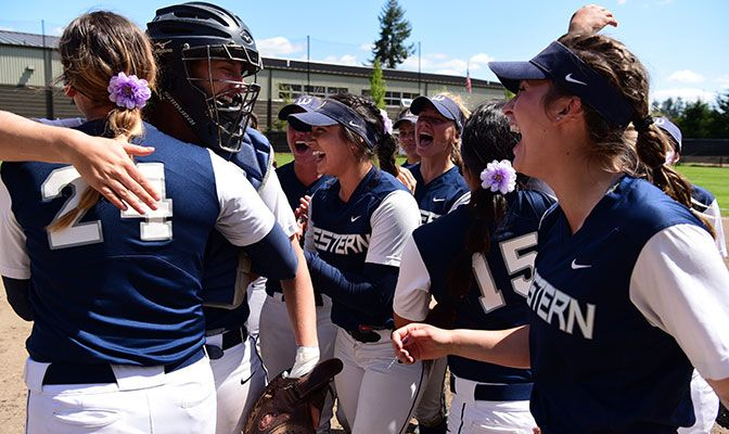 Anna Kasner (right) threw a GNAC Championships record 13 strikeouts in her second outing in the GNAC Softball Championships.