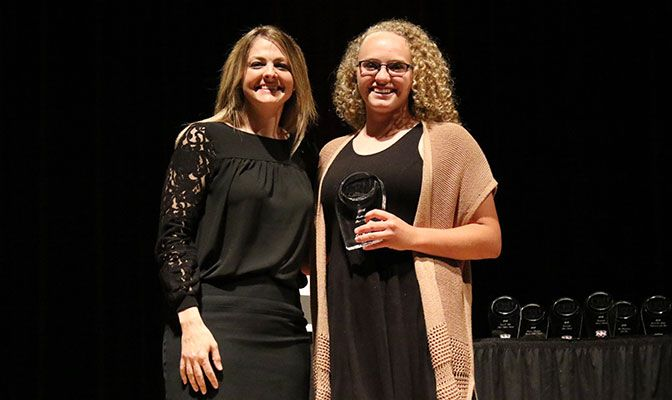 Lindley (left), shown here at an awards ceremony with former softball player Kim Orr, has been the athletic director at Northwest Nazarene since March 2015.