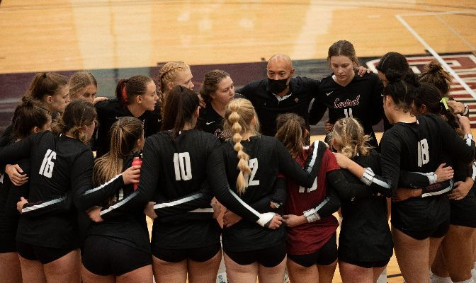 The Central Washington volleyball team huddles around head coach Mario Andaya. The Wildcats sit at 7-3 overall with a 3-1 conference mark after two GNAC wins this week.