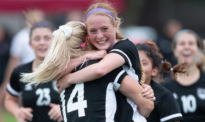 Freshman Lilly Nowatzke smiles as her teammates congratulate her after she scored an overtime game-winning goal to beat No. 7 SPU.