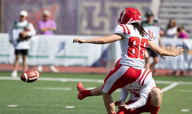 Kristie Elliott converted on this historic extra-point with 16 seconds left in the first half of Simon Fraser's game at Linfield. Photo by Naji Sakir/Linfield Athletics.