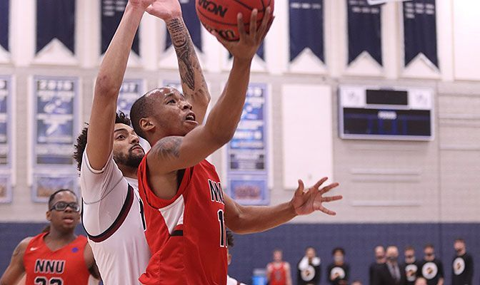 Ezekiel Alley connected on 9 of 18 from the field and 6 of 9 from three-point range to lead Northwest Nazarene to the final. Photo by Kris Parker.