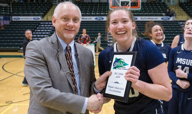 Alisha Breen, pictured with GNAC commissioner Dave Haglund, was named MVP after scoring 77 points in three games. Photo by Skip Hickey.