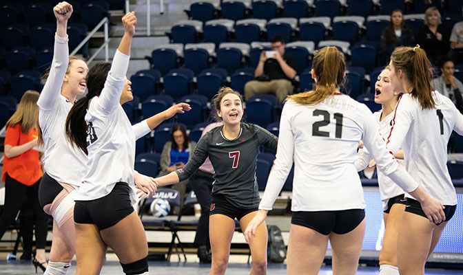 Kyla Morgan (center), the GNAC Defensive Player of the Year, finished with 21 digs in the victory.