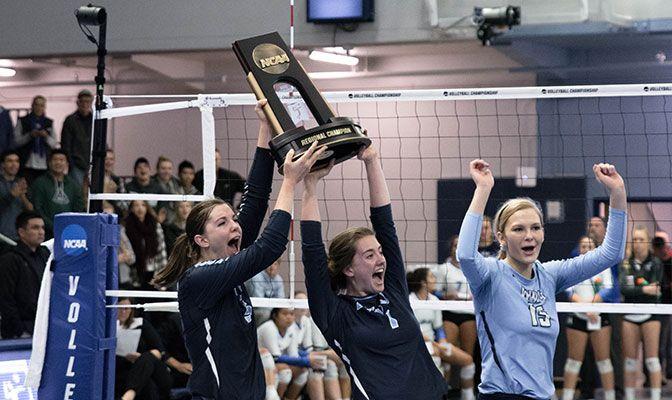 Seniors Abby Phelps (left), Brette Boesel (center) and Aubrey Stephens hoist the regional trophy in their final match inside Carver Gymnasium.