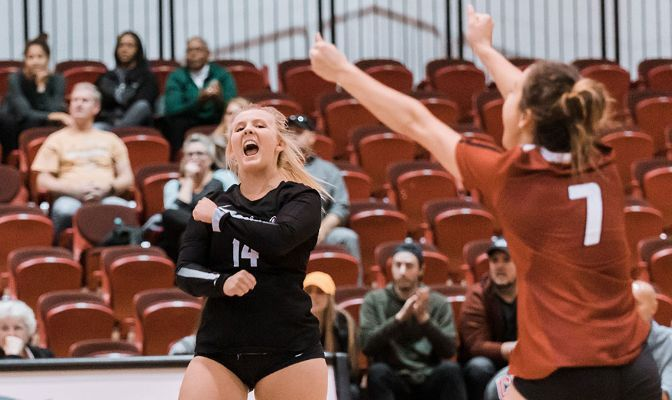 Sydney Remsberg (black jersey) appeared in 29 matches and started in two as a freshman in 2019, finishing with nine kills and 2.41 assists per set.