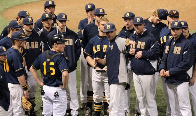 MSUB head coach Rob Bishop (center) leads his team into a crucial series against Northwest Nazarene this weekend that will have major postseason implications.