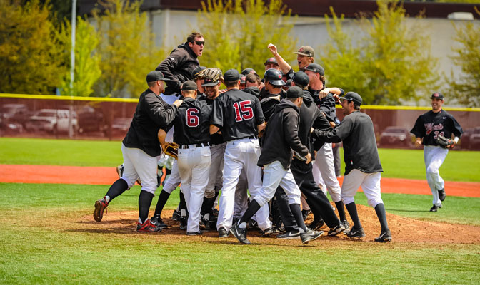 Central Washington celebrates after winning the 2014 GNAC Baseball Championships. Stuart Fewel (top) earned the win in the championship game.