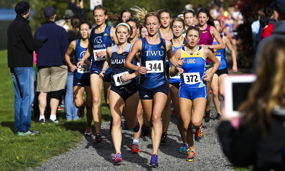 Sarah Inglis of Trinity Western (344) finished first in 41st annual Western Washington Cross Country Classic.  WWU's Katelyn Steen (left of Inglis) was top GNAC women's finisher placing third.