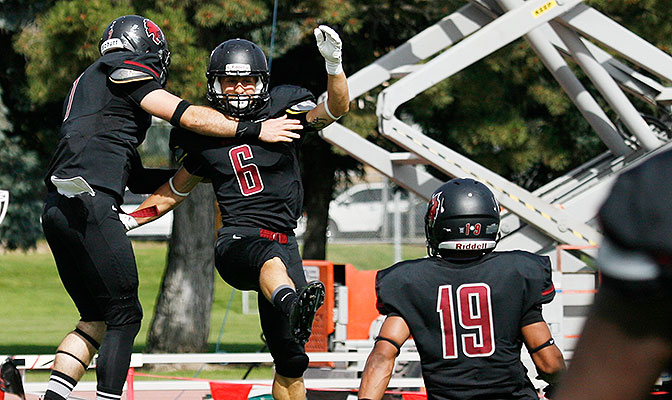 Jesse Zalk had a 95-yard kickoff return for a touchdown, changing the momentum in the Wildcats' 30-24 win at Simon Fraser.