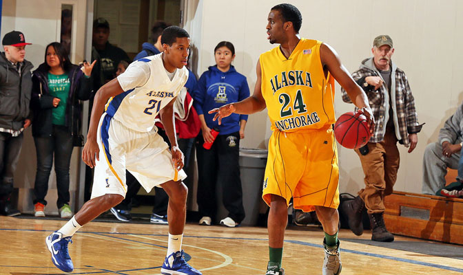Abebe Demissie (right) had 17 points and 10 rebounds in UAA's win,  while Andrew Kelly (left) led the Nanooks with eight rebounds.