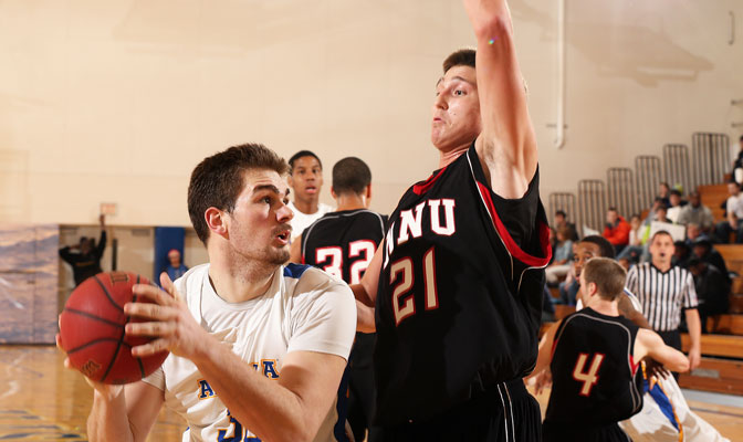 Pucar scored 36 points in Nanook road sweep at Western Oregon and Saint Martin's. Providing defense in a game earlier this season is Northwest Nazarene's Kevin Rima (21) (Photo by Paul McCarthy)