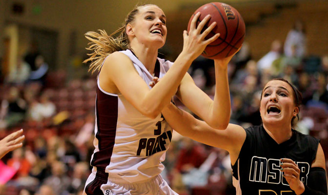 SPU's Katie Benson (left), guarded by MSUB's Janiel Olson in a game earlier this seaon, joined the 1,000-point club Thursday.