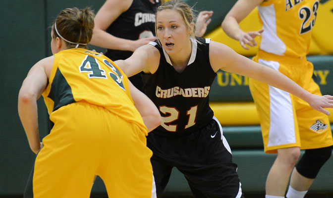 Megan Hingston (21), playing defense against UAA, leads the GNAC in scoring averaging 18.5 points per game (Photo by Sam Wassom)