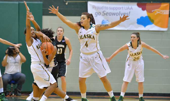 UAA's Alli Madison (4) and Kiki Robertson sandwich a Cameron player during the Seawolves' 86-70 victory last week.