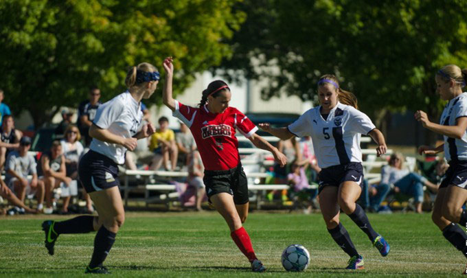 Lindsay Bauman (center in red) scored game-winning goal against MSU Billings. (Photo by Tim Miller)