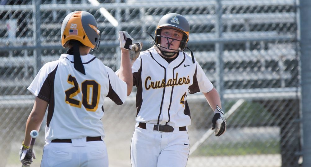 Taylor Nadler is congratulated by Mollie Lindeman after scoring one of her three runs on Friday afternoon.