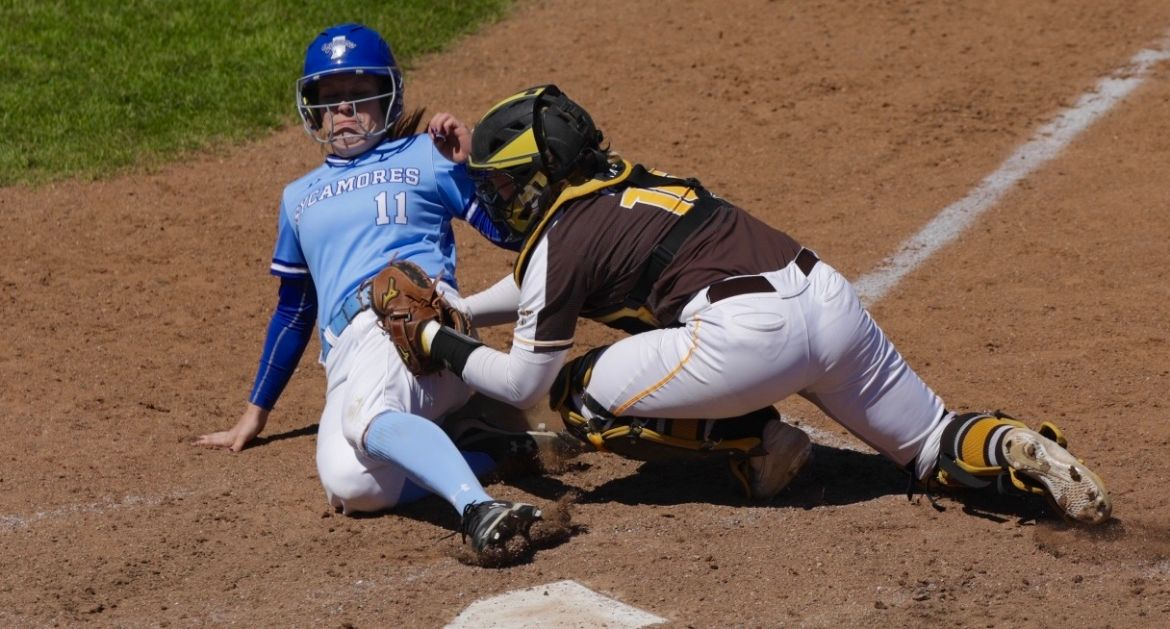 Hannah Dybalski tags out an Indiana State runner trying to score in Saturday's opener.