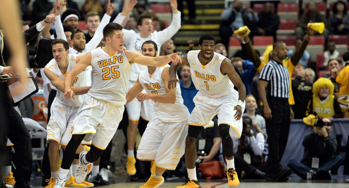The Crusaders celebrate following Peters' game-tying basket at the end of regulation. (Jose Juarez)
